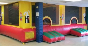 bounce house with 2 rooms and basketball hoops