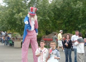 fair/festival event planning with stilt walker